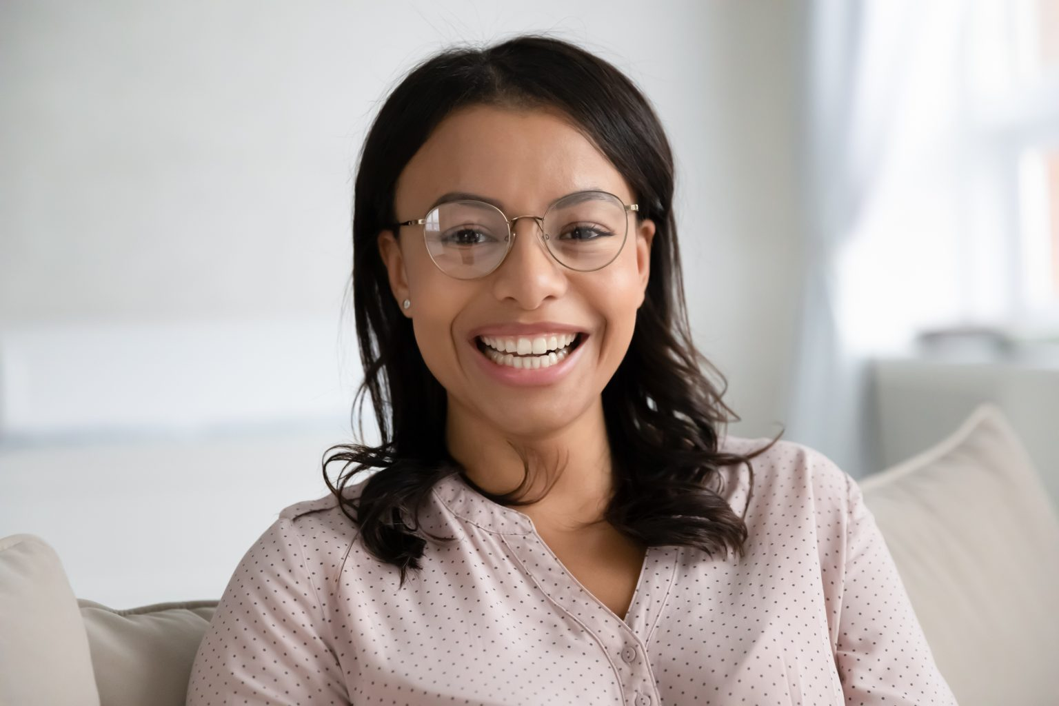Headshot Portrait Of Biracial Woman Relax On Couch